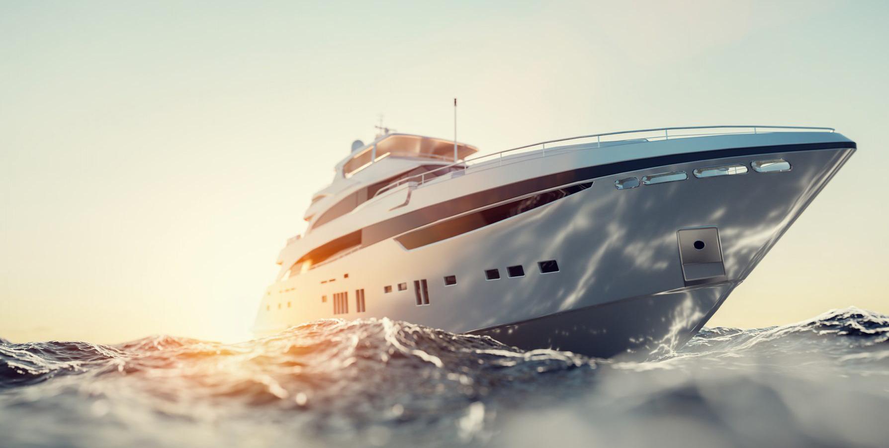 Luxury motor yacht on the ocean at sunset.